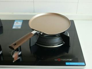 木瓜班戟,班戟锅放在炉子上,炉头设计合理,非常平。