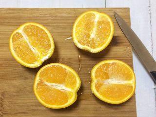 夏日小清新:橙子果冻,新鲜橙子切对半开。
