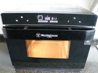 四喜蒸饺,接通电源,启动西屋蒸烤箱,选择菜单中的蒸汽功能,按确定键;