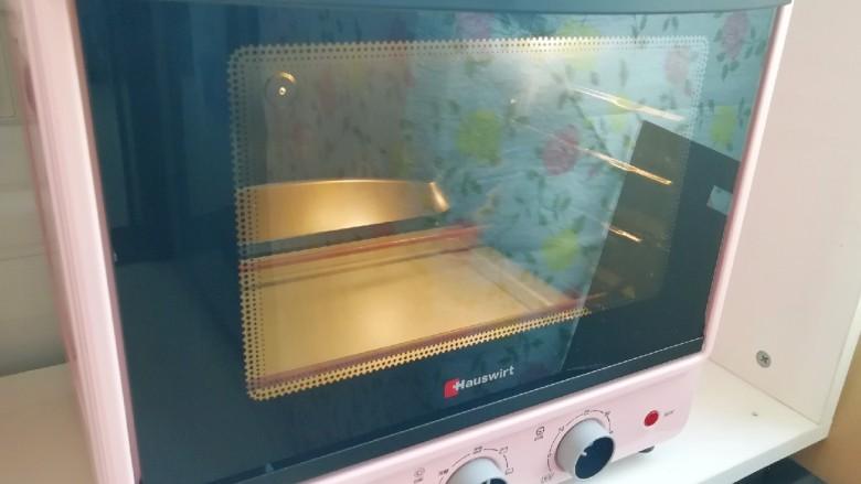 麦片芝麻核桃酥, 烤箱上下管165度预热。