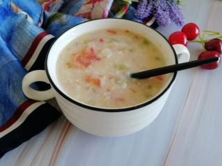 番茄丝瓜补钙粥,搅拌均匀后,端出桌,开吃开吃!