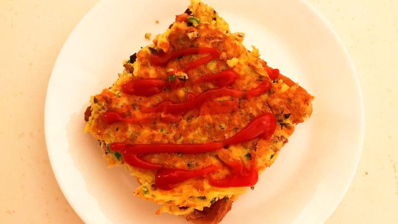 芝士火腿三明治,在火腿鸡蛋饼上面加入番茄酱